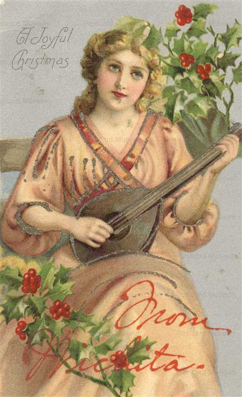 xm865-Christmas Wichita Lady Playing Guitar Glitter