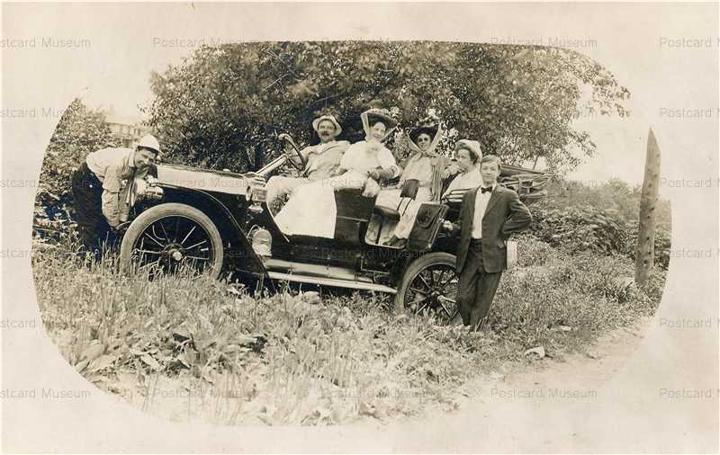 car090-Couples Taking Trip in Early Automobile