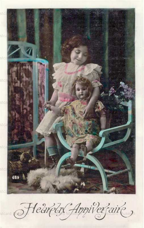 do014-Girl with Doll in Chair