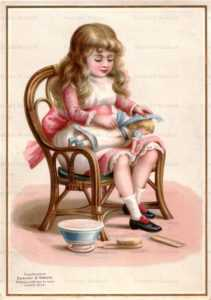 c020-Girl Straighten Doll's Clothes
