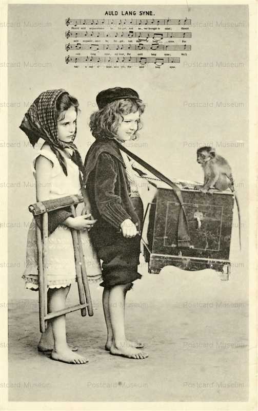 ag710-Boy Organ Grinder with Girl & Monkey