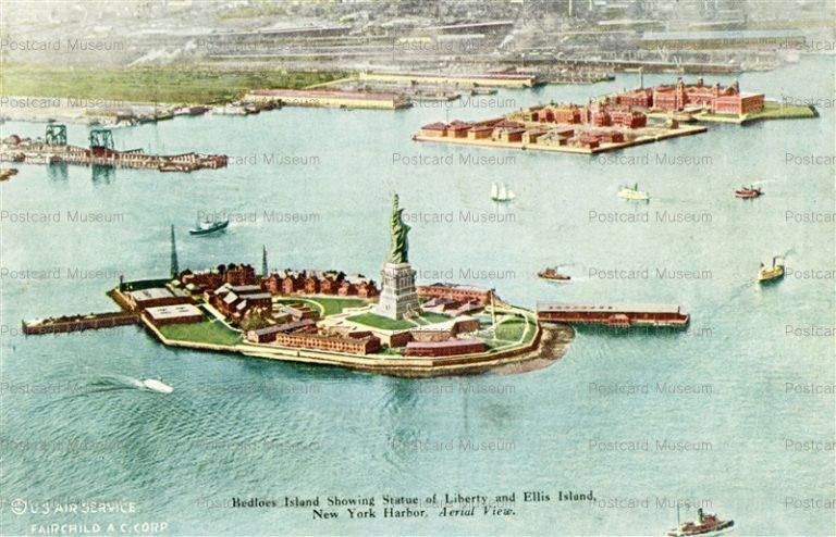 usa056-Bedloes Island Showing Statue of Liberty and Ellis Island New York Harbor